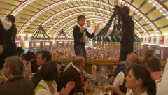 Octoberfest Munich beer hall - wide shot of tent, dancing on balcony Stock Footage