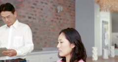 Pregnant asian couple planning together Stock Footage