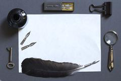 Vintage writing set with a white sheet of paper - stock photo