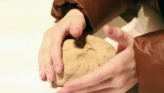 Child playes with kinetic sand. Stock Footage
