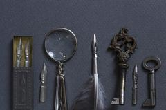 Vintage writing set on a gray cardboard background Stock Photos
