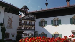 Traditional Bavarian building in southern Germany with red flowers Stock Footage