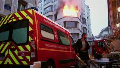 Stock Video Footage of Fire Urgency in Central Paris with firefighters action