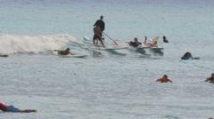 Crowds surfing at waikiki beach, hawaii Stock Footage