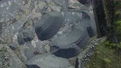 4k aerial rock quarry from above with wide upwards pan of area Stock Footage