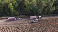4k aerial corn harvest tractors switch load trailers on the fly Stock Footage