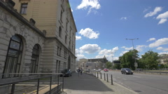 Walking and driving near the Main Railway Station building in Prague Stock Footage