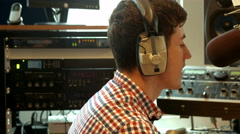Student presenting a radio show in studio Stock Footage