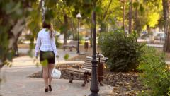 The woman limps in shoes Stock Footage