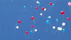 Multi-colored spheres fly on the blue sky Stock Footage