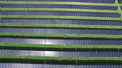 4k aerial solar farm directly above with sun glare - stock footage