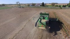 4k aerial closeup behind combine working Stock Footage