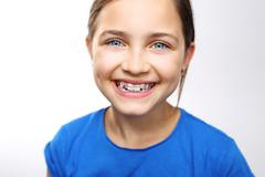 Child with orthodontic appliance. - stock photo