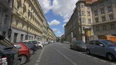 Driving a car near others cars parked on Senovazne namesti, Prague Stock Footage