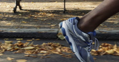 Close up feet running Runner man in park exercising outdoors - stock footage