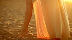 Young girl big legs seductive silhouette sexy woman develops to sunset yellow Stock Footage