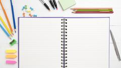 notepad with office supplies - stock photo