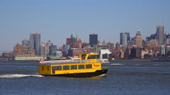 New York water taxi crossing the Hudson River en route to New York City. - stock footage