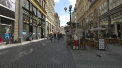 Tourists passing by outdoor restaurants on 28 October street, Prague Stock Footage