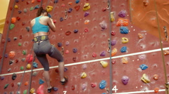 Stock Video Footage of Rock climber descending the wall
