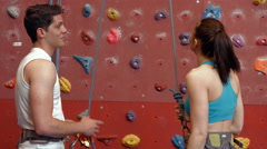 Stock Video Footage of Rock climbers talking by the wall