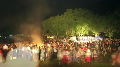 Thousands of people move quickly folklore festival in the mountains at night Stock Footage