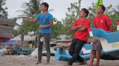 Boys kite flying on the beach,Pangandaran,Java,Indonesia Stock Footage