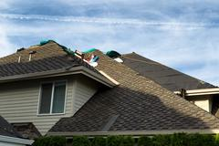 Stock Photo of Home roof being replaced with new composite roofing materials