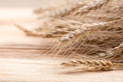 wheat on wood - stock photo