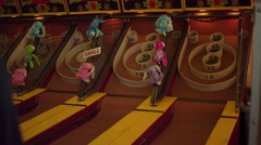 Someone scoring high points in skee ball Stock Footage