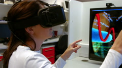 Scientist using oculus rift in lab Stock Footage