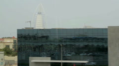 view from a moving subway train to the hotel Burj Al Arab - stock footage