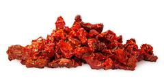Pile of ripe red dried tomatoes - stock photo