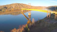 Aerial Shot Ascending Over Trees River Suspension Bridge Mountains Drone Footage Stock Footage
