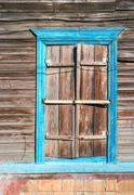 Wooden window with frame painted in blue color, Astrakhan, Russia Stock Photos