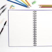 Notepad with office supplies Stock Photos