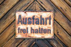 EXIT free GermanSign on Timber Wall Background - stock photo