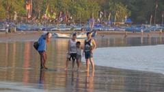 Photographer makes photo 3 boys,Pangandaran,Java,Indonesia Stock Footage
