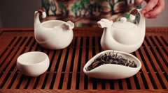 Tea ceremony. Woman pours a tea Stock Footage