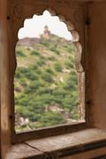 Ornated window of the Amber fort, Jaipur - stock photo