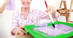 Mother and daughter redecorating together Stock Footage