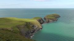View of Ynys Lochtyn headland from the coastal path near Llangrannog, Wales, UK Stock Footage
