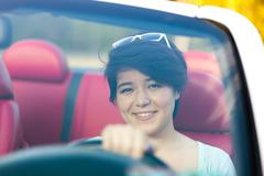 Woman Driving a Convertible Stock Photos