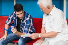 Elder man needing help - stock photo