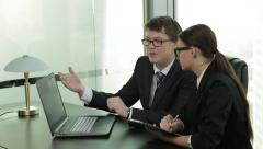 Businessman gives orders to a subordinate employee young attractive woman Stock Footage
