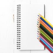 notepad with color pencil - stock photo