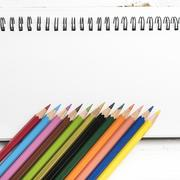 Notepad with color pencil Stock Photos