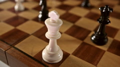Black queen checkmates white king in chess game. Stock Footage
