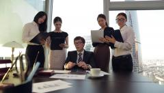 Businessman giving orders to his young and beautiful secretaries. Stock Footage
