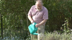 Gardening elderly Senior retired grandfather at man retirement age outdoors Stock Footage